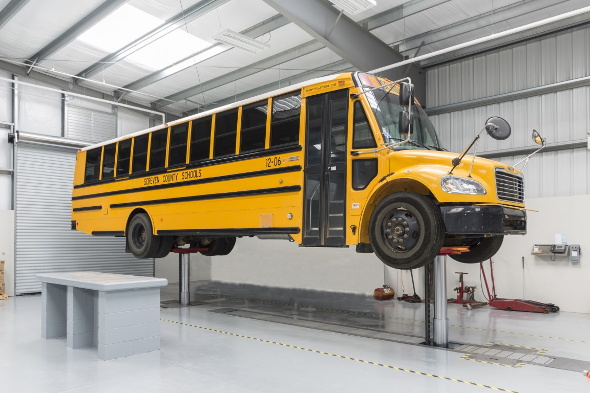 American School Bus Lifted with In-Ground Piston DIAMONDLIFT